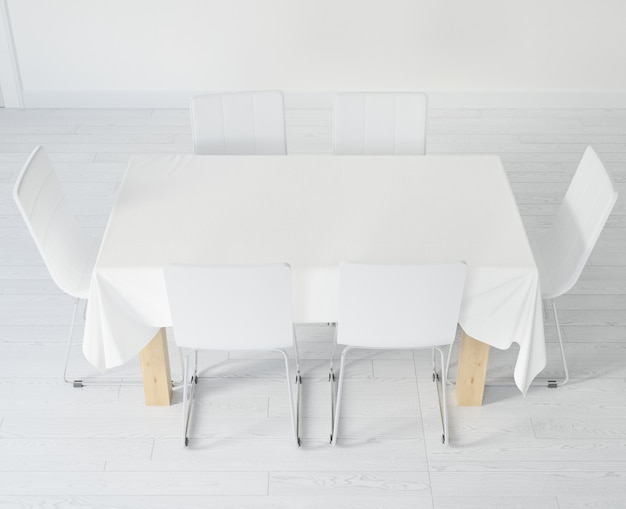 Table with tablecloth and chairs