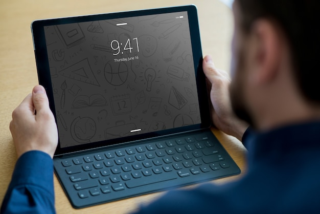 Tablet mockup with keyboard and man