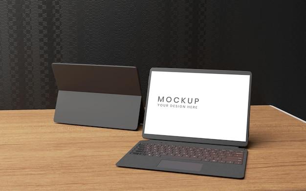 나무 테이블에 키보드와 태블릿 모형