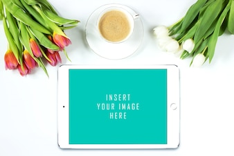 Tablet on white background with flowers mock up
