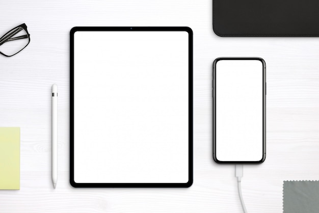 Tablet and phone mockup on desk. top view, flat lay scene with separated layers