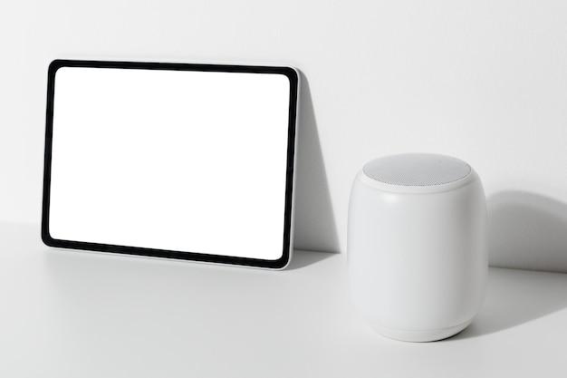 Tablet screen mockup with smart speaker