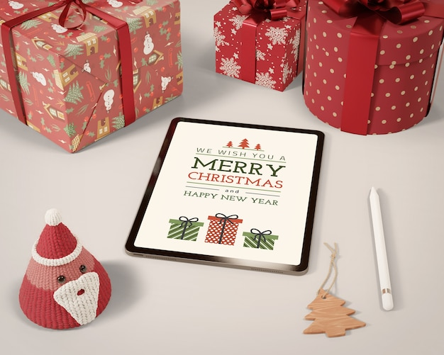 Tablet and set of gift collection on table