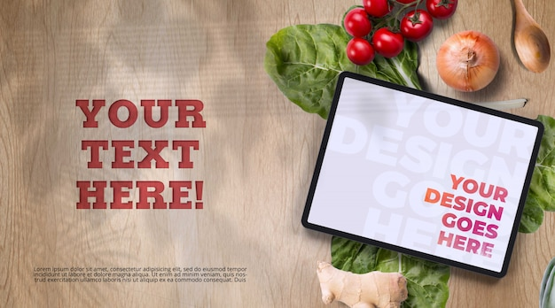 Tablet surrounded with organic vegetables mockup