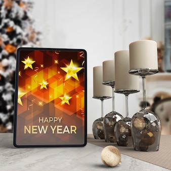 Tablet on table with wish for new year night