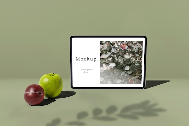 Tablet with apple and plum