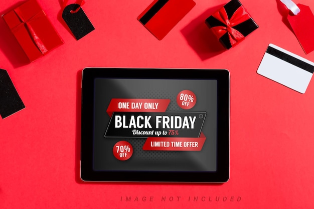 Tablet with black friday mockup on screen and shopping accessories