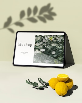 Tablet with citrus and leaves
