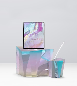 Tablet with mockup screen on beautiful glass surface