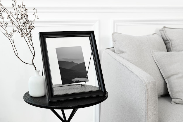 Tabletop picture frame mockup psd on the living room's table