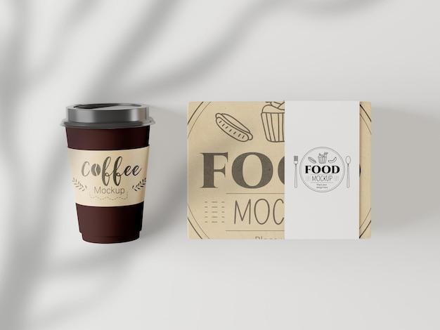 Уберите кофейную чашку и макет пакета с едой