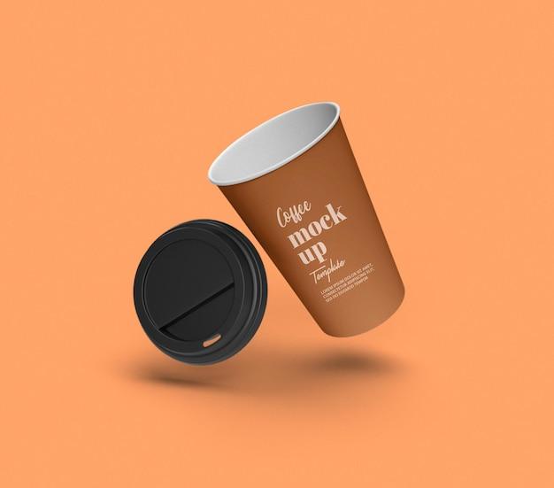 飛んでいる紙のコーヒー カップのモックアップを取り除く