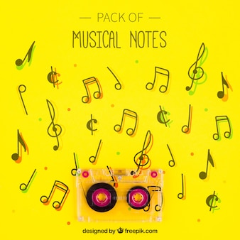 Tape on yellow musical notes background