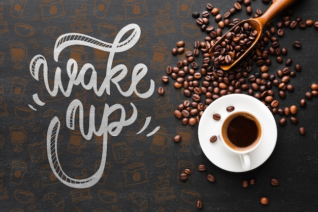 Tasty cup of coffee and coffee beans background