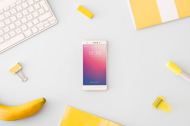 Technology and workspace mockup with smartphone