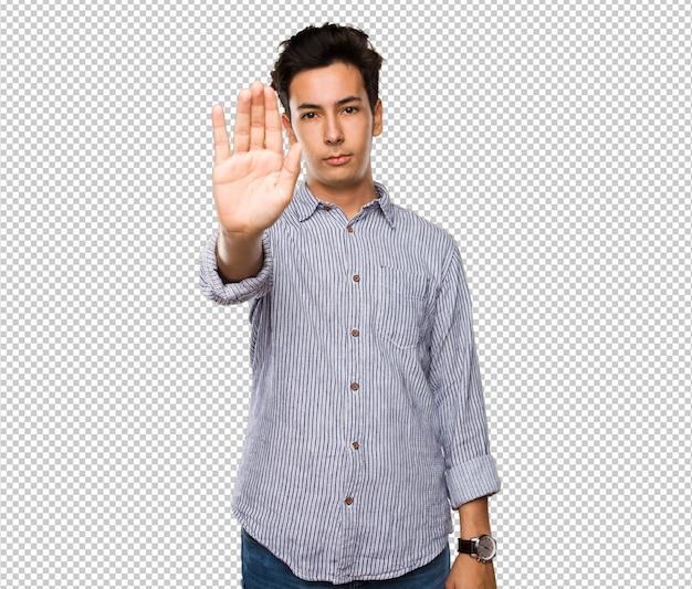 Teenager doing stop gesture