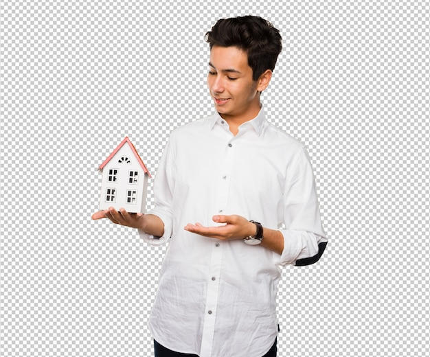 Teenager holding a house