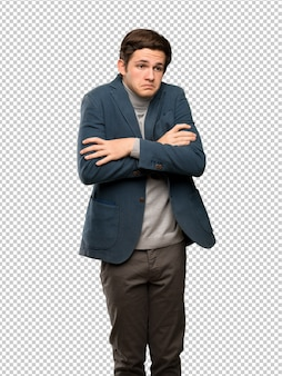 Teenager man with turtleneck making doubts gesture while lifting the shoulders