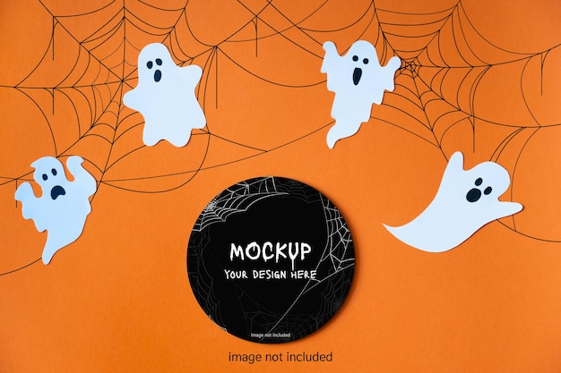 Template for halloween with decorative cute ghosts on orange background. black circle layout. mock up
