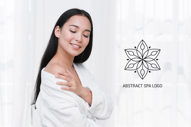 Template smiling woman at spa after massage