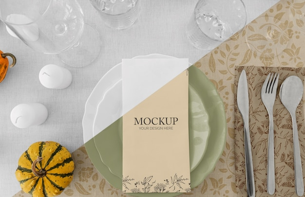 Thanksgiving dinner table arrangement with cutlery and glasses
