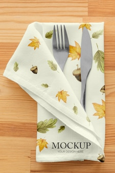Thanksgiving dinner table arrangement with cutlery in napkin