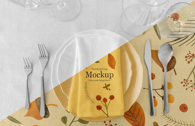 Thanksgiving dinner table arrangement with napkin and cutlery