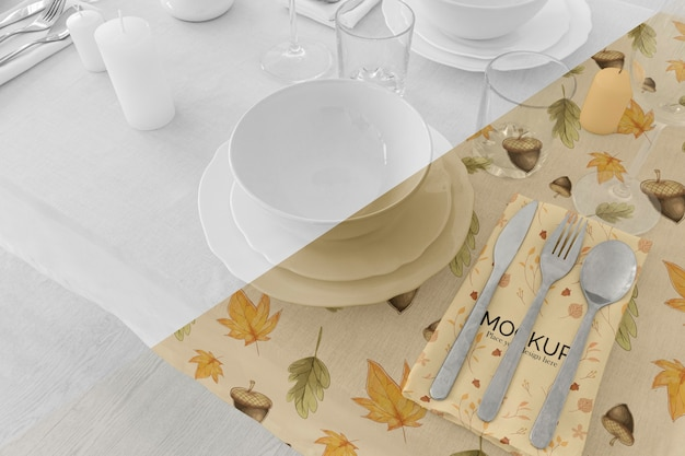 Thanksgiving dinner table arrangement with plates and glasses
