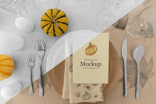 Thanksgiving dinner table arrangement with pumpkin and plates