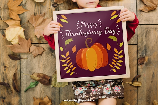 Thanksgiving mockup with girl holding frame