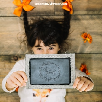 Thanksgiving mockup with girl holding slate