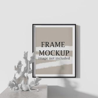 Thin black frame mockup on wall