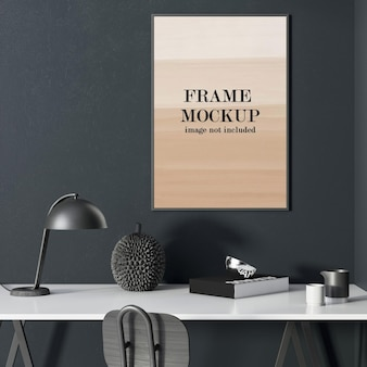 Thin picture frame on dark wall above white table