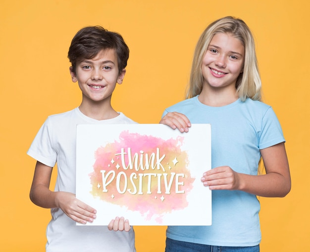Think positive boy and girl mock-up