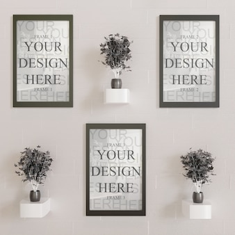 Three horizontal frame mockup on wall with black decorative plants