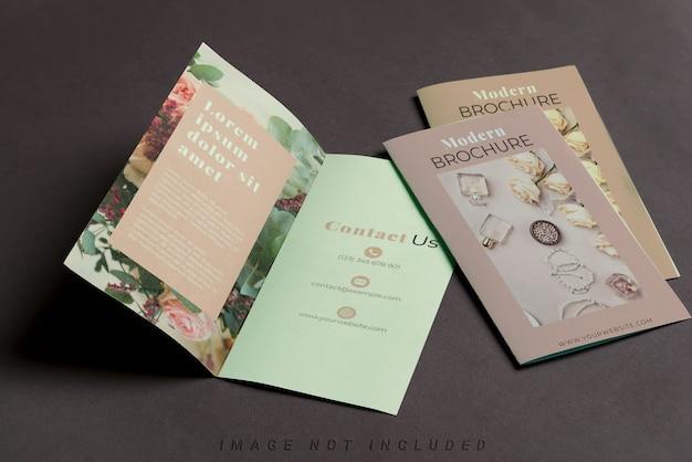 Three mockup brochures on black table