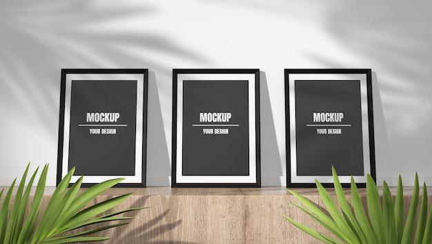 그림자에 세 사진 프레임 모형 나뭇잎 배경