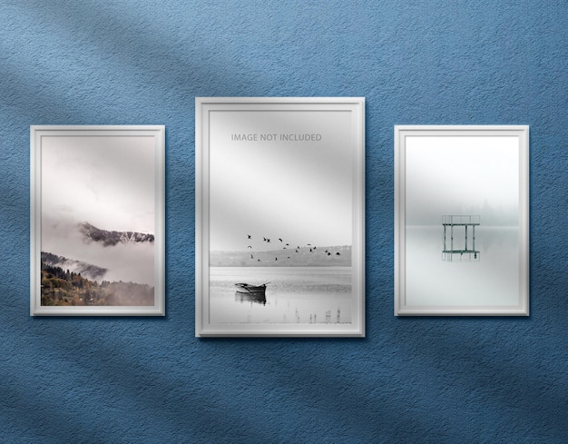 Three photo frame mockup on wall