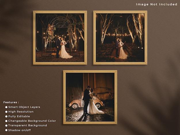 3개의 정사각형 나무 사진 프레임이 그림자가 있는 벽 배경에 매달려 있습니다.