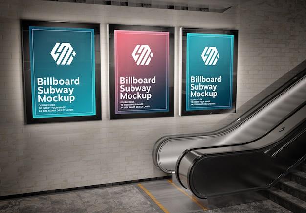 Три вертикальных светящихся рекламных щита в мокапе станции метро