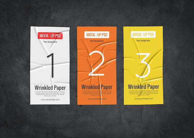 Three wrinkled paper mockup on a dark surface