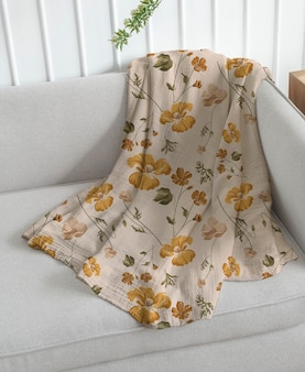 Throw blanket mockup psd in floral pattern living concept
