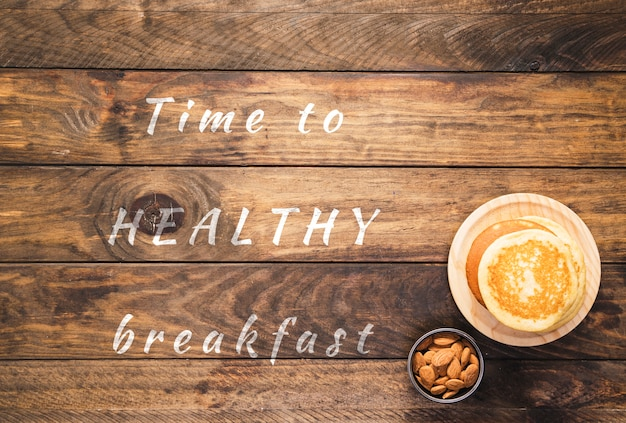 Time to healthy breakfast quote on wooden board
