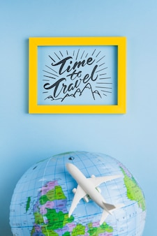Time to travel, lettering frame with earth globe and airplane