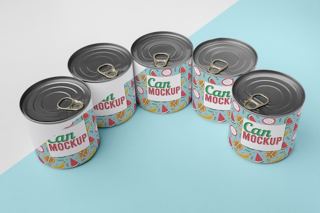 Tin cans arranged on table