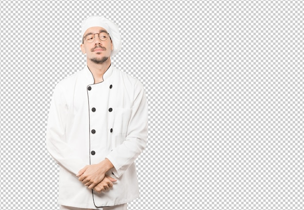 Tired young chef doing a gesture of boredom