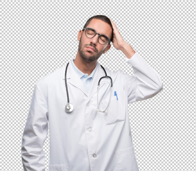 Tired young doctor posing