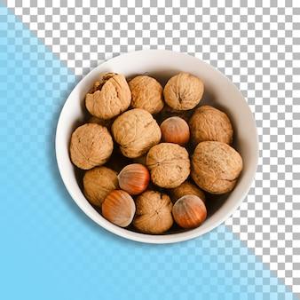 Сверху вид кучу грецких орехов на белой миске, изолированные с прозрачным фоном.