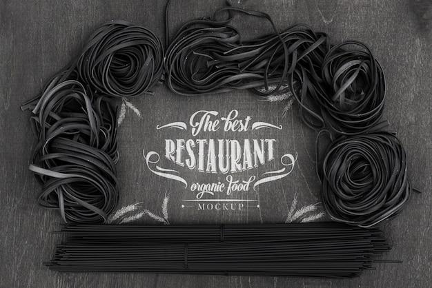 Top view arrangement of dark spaghetti mock-up