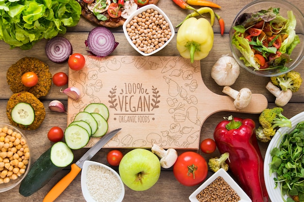 Top view arrangement with delicious food and cutting board